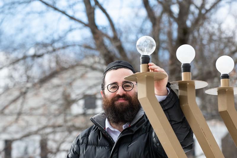 Rabbi Avremy Raskin poses next to the Menorah; KELLY FLETCHER, REFORMER CORRESPONDENT.