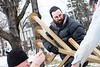 Rabbi Avremy Raskin and Adam Ziegner assemble the menorah with a little help from Christopher Derby.  KELLY FLETCHER, REFORMER CORRESPONDENT