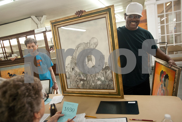 Elroy McDaniel of Tyler submits two of his works of art for the adult art competition at Building A at the East Texas State Fairgrounds in Tyler Thursday Sept. 10, 2015. The East Texas State Fair runs Sept. 25 to Oct. 4.   (Sarah A. Miller/Tyler Morning Telegraph)