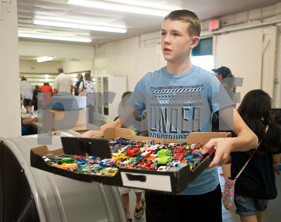 Zane Schaeffer, 15, of Ben Wheeler carries his fair project-- a toy car collection-- to be checked in at Building A at the East Texas State Fairgrounds in Tyler Thursday Sept. 10, 2015. The East Texas State Fair runs Sept. 25 to Oct. 4.   (Sarah A. Miller/Tyler Morning Telegraph)