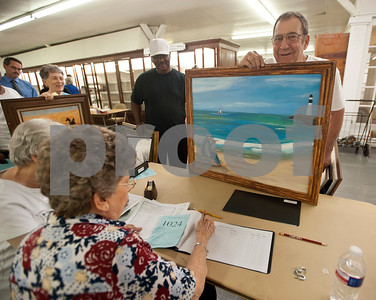 Larry Harrison of Tyler submits an oil panting he made for the adult art competition at Building A at the East Texas State Fairgrounds in Tyler Thursday Sept. 10, 2015. The East Texas State Fair runs Sept. 25 to Oct. 4.   (Sarah A. Miller/Tyler Morning Telegraph)