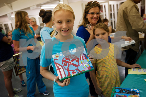Sarah Pratt, 10, of Tyler, entered a piece of art in the Fair Fun category, a special category for the 100th anniversary of the fair, at the East Texas State Fairgrounds in Tyler Thursday Sept. 10, 2015. The East Texas State Fair runs Sept. 25 to Oct. 4.   (Sarah A. Miller/Tyler Morning Telegraph)