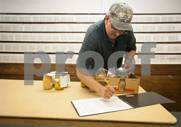 Volunteer Doug Garner records information from canned foods submitted at Building A at the East Texas State Fairgrounds in Tyler Thursday Sept. 10, 2015. The East Texas State Fair runs Sept. 25 to Oct. 4.   (Sarah A. Miller/Tyler Morning Telegraph)