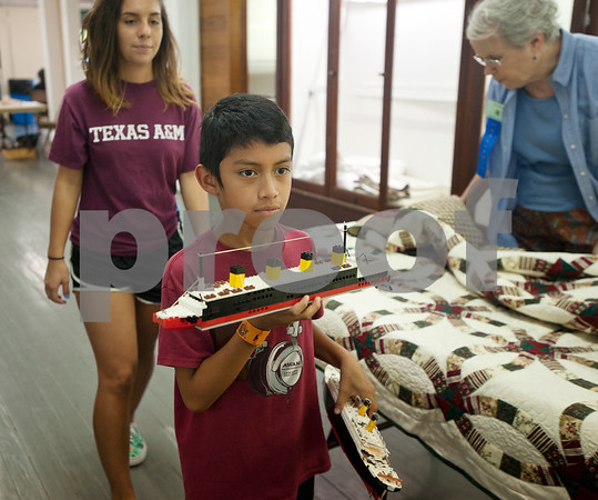 Isaac Robinson, 11, of Lindale, drops off his fair project, ships made from Legos, at Building A at the East Texas State Fairgrounds in Tyler Thursday Sept. 10, 2015. The East Texas State Fair runs Sept. 25 to Oct. 4.   (Sarah A. Miller/Tyler Morning Telegraph)