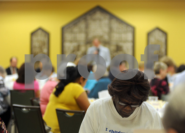 copyright 2012 Sarah A. Miller/Tyler Morning Telegraph  PATH volunteer Shirley Oliver of Tyler bows her head in prayer during the blessing at the PATH Week Prayer Luncheon held Tuesday at Christ Episcopal Church in Tyler.