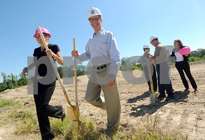 copyright 2012 Sarah A. Miller/Tyler Morning Telegraph  Kennis Ketchum of Portfolio Development and Fred Secker, co-owner of the apartment complex, return their shovels after participating in the groundbreaking ceremony of The Palomer Luxury Apartments in Tyler Tuesday.