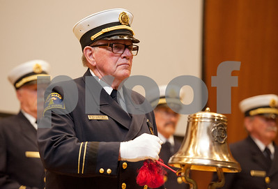 photo by Sarah A. Miller/Tyler Morning Telegraph  W.A. Richardson of McKinney rings a bell at the University of Texas at Tyler Thursday in honor of those who lost their life in the Sept. 11, 2001 attacks. Richardson is a member of the Dallas Retired Firefighters Association Honor Guard.