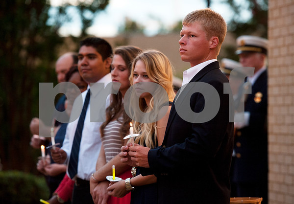 photo by Sarah A. Miller/Tyler Morning Telegraph  University of Texas at Tyler Student Government Association members including student senator Jacob VanDerSchans, far right, and vice president Rebecca Hansen hold lighted candles during a vigil Thursday in honor of those who lost their life in the Sept. 11, 2001 attacks.
