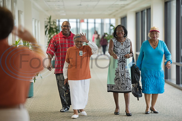 UT Health Tyler volunteer Vennie Jackson waves as she arrives to her birthday party with her nephew Vincent Victory and cousins Ella Spikes and Dorothy Jackson on Tuesday Sept. 11, 2018. Jackson has volunteered at the hospital for 30 years.  (Sarah A. Miller/Tyler Morning Telegraph)