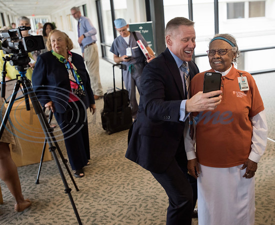 Moody Chisholm, President and CEO of  UT Health East Texas Birthday takes a selfie with UT Health Tyler volunteer Vennie Jackson as she celebrates her 100th birthday with a party at the hospital on Tuesday Sept. 11, 2018.  She has volunteered at the hospital for 30 years.  (Sarah A. Miller/Tyler Morning Telegraph)