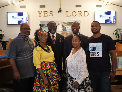 Pastor Melton Timmons of Jones Valley Church is joined by Kim and Patrick Smith, Emmett Shankle III, Rhonda Brinkley, and Patrick Seymour during the 100 Faces of Freedom event. Sarah Perez/Freelance