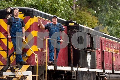 Conductor Dan Volker and engineer Larry Pitbladdo pose for a photo on a train at the Texas State Railroad Rusk Depot in Rusk, Texas, on Tuesday, Sept. 12, 2017. The Texas State Railroad is a historic 25-mile railroad between Rusk and Palestine, Texas. Founded in 1881 by the state of Texas to haul freight, regular service on the line was ended in 1921, but rides still run weekly for the community to experience the railroad and the depots host special events seasonally. (Chelsea Purgahn/Tyler Morning Telegraph)