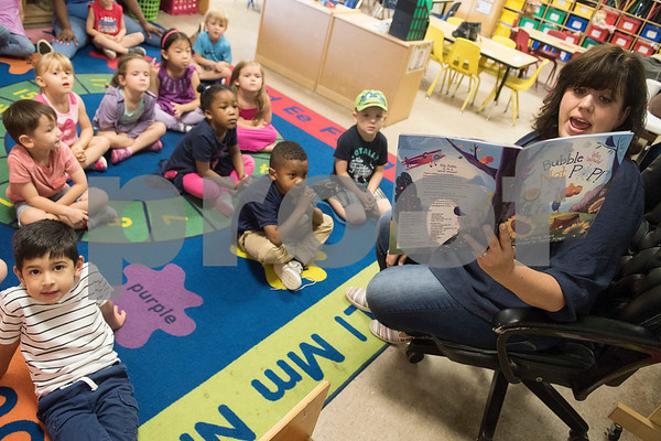 """Christian author Shelly Roark reads her children's book """"The Bubble Who Would Not Pop"""" to children in the early education program at Trinity Lutheran Church Friday Sept. 1, 2017.  (Sarah A. Miller/Tyler Morning Telegraph)"""