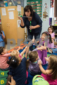 """Christian author Shelly Roark blows bubbles before reading her children's book """"The Bubble Who Would Not Pop"""" to children in the early education program at Trinity Lutheran Church Friday Sept. 1, 2017.  (Sarah A. Miller/Tyler Morning Telegraph)"""