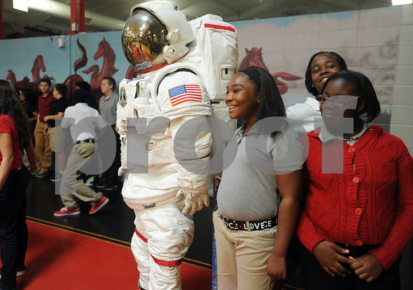 copyright 2012 Sarah A. Miller/Tyler Morning Telegraph  Six graders Quindisha Jett, 11, and Clarissa Williamson, 11, get an up close look at a spacesuit after a school assembly featuring NASA Engineer Mallory Jennings at Moore MST Magnet School Thursday. Jennings is part of the crew and thermal systems division that maintains and develops spacesuits for NASA.