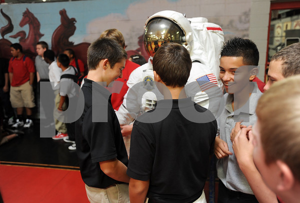 copyright 2012 Sarah A. Miller/Tyler Morning Telegraph  Students get an up close look at a spacesuit after a school assembly featuring NASA Engineer Mallory Jennings at Moore MST Magnet School Thursday. Jennings is part of the crew and thermal systems division that maintains and develops spacesuits for NASA.