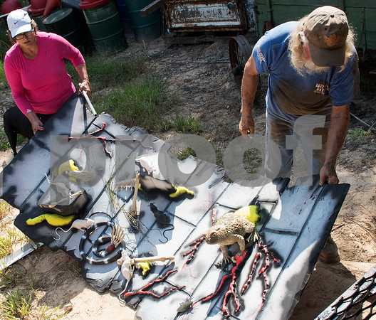 Freda Malone and Charlie Harris move decorations into a new spooky themed attraction at Yesterland Farm in Canton  Sept. 14, 2017. The farm is hosting their Grand Re-Opening weekend Sept. 23 and 24. The facility has been updated throughout the summer after a tornado hit the property on Interstate 20 in April 2017.  (Sarah A. Miller/Tyler Morning Telegraph)