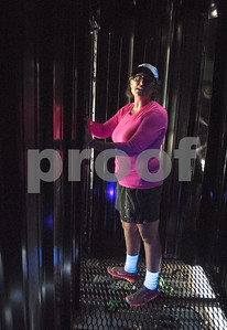 Freda Malone installs black light and glow-in-the-dark decorations into a new spooky themed attraction at Yesterland Farm in Canton  Sept. 14, 2017. The farm is hosting their Grand Re-Opening weekend Sept. 23 and 24. The facility has been updated throughout the summer after a tornado hit the property on Interstate 20 in April 2017.  (Sarah A. Miller/Tyler Morning Telegraph)