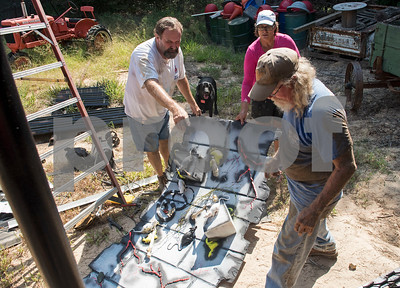 Larry Byford, Freda Malone and Charlie Harris move decorations into a new spooky themed attraction at Yesterland Farm in Canton  Sept. 14, 2017. The farm is hosting their Grand Re-Opening weekend Sept. 23 and 24. The facility has been updated throughout the summer after a tornado hit the property on Interstate 20 in April 2017.  (Sarah A. Miller/Tyler Morning Telegraph)