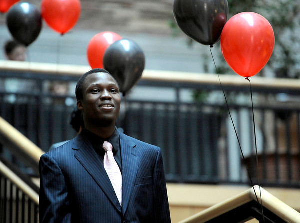Elom Amouzou models  a dark suit during a fashion show for the Suit Yourself sale in the UMC atrium at the University of Colorado in Boulder, Colorado September 15, 2011.   CAMERA/Mark Leffingwell