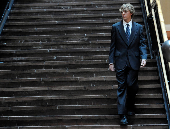 Michael Von Hendy walks down the atrium stairs modeling a suit and tie that will be available for sale at the Suit Yourself sale next Tuesday at the University of Colorado in Boulder, Colorado September 15, 2011.   CAMERA/Mark Leffingwell