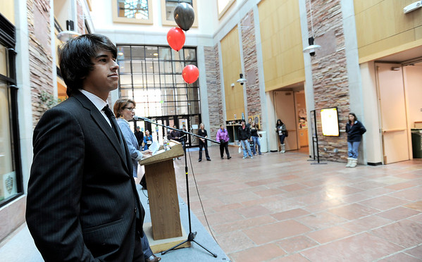 Bryan Tupper stands on stage dressed in a dark suit during a fashion show for the Suit Yourself sale in the UMC atrium at the University of Colorado in Boulder, Colorado September 15, 2011.   CAMERA/Mark Leffingwell