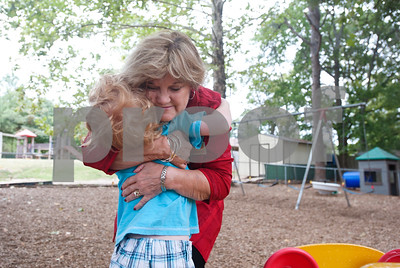 photo by Sarah A. Miller/Tyler Morning Telegraph  The Growing Stick Learning Center owner Cynthia Nance hugs pre-K child Owen Brandt, 4, during recess Thursday morning at the center in Tyler. The Growing Stick serves kids 18 months to pre-K during the day and is in its 25th year of operation.