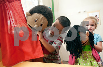 photo by Sarah A. Miller/Tyler Morning Telegraph  Isaac Tovar, 3, and Harley Boone, 3, play with puppets together at the Growing Stick Learning Center Thursday morning in Tyler. The Growing Stick serves kids 18 months to pre-K during the day and is in its 25th year of operation.