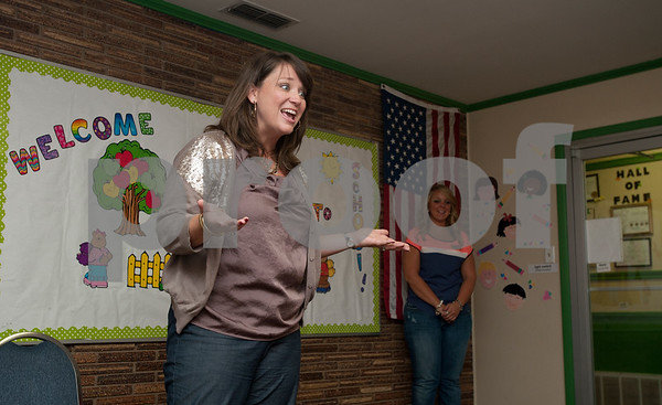 photo by Sarah A. Miller/Tyler Morning Telegraph  The Growing Stick Learning Center DirectorSusan Soward leads children in songs Thursday morning at the center in Tyler. The Growing Stick serves kids 18 months to pre-K during the day and is in its 25th year of operation.
