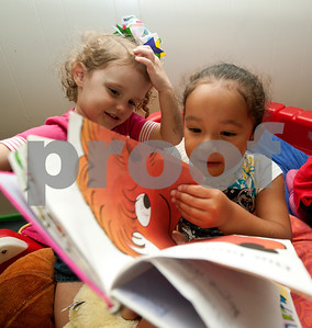 photo by Sarah A. Miller/Tyler Morning Telegraph  Ella Cheatham, 3, and Gabryel Kissam, 3, read a book together at the Growing Stick Learning Center Thursday morning in Tyler. The Growing Stick serves kids 18 months to pre-K during the day and is in its 25th year of operation.