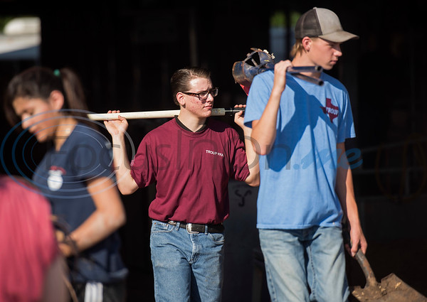 Troup High School senior Chase Griffin, 17, center, carries a shovel to compete in the Horticulture Show Landscape Design Competition at the East Texas State Fair on Wednesday Sept. 19, 2018. Teams from local high schools competed in designing and making a themed 4 foot by 7 foot planter box.  (Sarah A. Miller/Tyler Morning Telegraph)