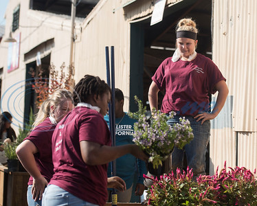 Troup High School junior Harlee Hunter, 16, stands in her team's planter during the Horticulture Show Landscape Design Competition at the East Texas State Fair on Wednesday Sept. 19, 2018. Teams from local high schools competed in designing and making a themed 4 foot by 7 foot planter box.  (Sarah A. Miller/Tyler Morning Telegraph)