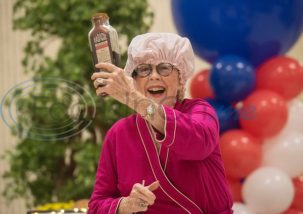 Dee Kirkpatrick does a skit where medicine gives her the energy to dance with the Flappers dance group from the Tyler Senior Center for Senior Day at the East Texas State Fair on Friday Sept. 20, 2019.   (Sarah A. Miller/Tyler Morning Telegraph)