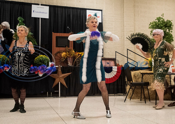 The Flappers dance group from the Tyler Senior Center perform for Senior Day at the East Texas State Fair on Friday Sept. 20, 2019. Pictured from left: Martha Morrill, Mindy Lyons and Dee Kirkpatrick.  (Sarah A. Miller/Tyler Morning Telegraph)