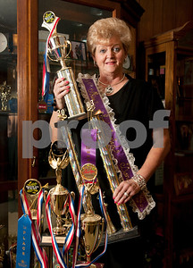 copyright 2012 Sarah A. Miller/Tyler Morning Telegraph   Carol Swanson, 65, of Tyler holds the Top Novice Award for the best dancer with two or less years of experience. She stands next to her largest award, which is a group dance award for first place from Talent on Parade. Swanson competes in both dance and pageants for adults.