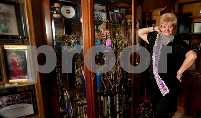 copyright 2012 Sarah A. Miller/Tyler Morning Telegraph   Carol Swanson, 65, of Tyler strikes a pose by her collection of awards and trophies she has earned competing in pageants and dance competitions as a senior adult.