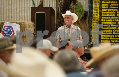 photo by Sarah A. Miller/Tyler Morning Telegraph  Bid taker Don Malone watches for bids at the Hay Show & Auction held Monday at the East Texas State Fair in Tyler. Top scoring bales of hay from the show were auctioned off with proceeds benefiting the East Texas State Fair Junior Livestock Show, East Texas Cattle-Ettes Scholarships and Soil & Water Conservation District programs.
