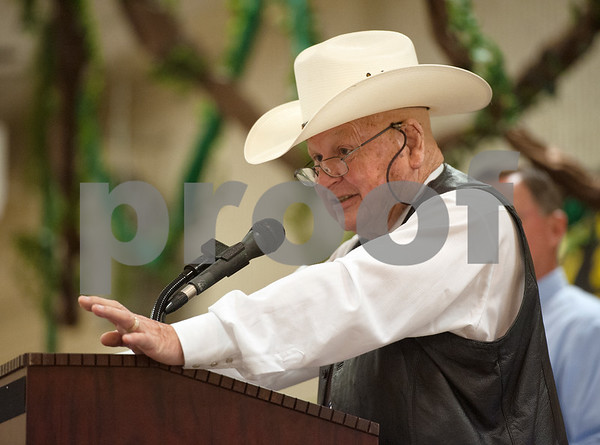 photo by Sarah A. Miller/Tyler Morning Telegraph  Auctioneer Jack Dillard of Waskom gets the bidding started at the Hay Show & Auction held Monday at the East Texas State Fair in Tyler. Top scoring bales of hay from the show were auctioned off with proceeds benefiting the East Texas State Fair Junior Livestock Show, East Texas Cattle-Ettes Scholarships and Soil & Water Conservation District programs.