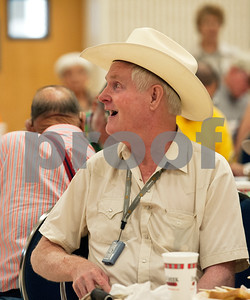 photo by Sarah A. Miller/Tyler Morning Telegraph  Bidder Richard Griffin laughs as auctioneer Jack Dillard (not pictured) keeps the atmosphere light and fun at the Hay Show & Auction held Monday at the East Texas State Fair in Tyler. Top scoring bales of hay from the show were auctioned off with proceeds benefiting the East Texas State Fair Junior Livestock Show, East Texas Cattle-Ettes Scholarships and Soil & Water Conservation District programs.