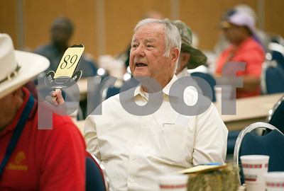 photo by Sarah A. Miller/Tyler Morning Telegraph  Ken Threlkeld of Threlkeld Company Insurance in Tyler makes a winning bid during the Hay Show & Auction Monday at the East Texas State Fair in Tyler. Top scoring bales of hay from the show were auctioned off with proceeds benefiting the East Texas State Fair Junior Livestock Show, East Texas Cattle-Ettes Scholarships and Soil & Water Conservation District programs.