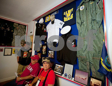 Veterans sit in front of a wall decorated with items from the U.S. Navy during an open house event at The Green Zone in Tyler. The Green Zone is a resource center for veterans ran by veterans. Located at 512 Charnwood in Tyler, The Green Zone is open with peer councilors available from 9 a.m. to 5 p.m.   (Sarah A. Miller/Tyler Morning Telegraph)