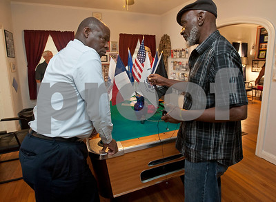 Veterans Waymon Stewart and Jerome McKnight talk during an open house Wednesday. The Green Zone is a resource center for veterans ran by veterans. Located at 512 Charnwood in Tyler, The Green Zone is open with peer councilors available from 9 a.m. to 5 p.m.   (Sarah A. Miller/Tyler Morning Telegraph)
