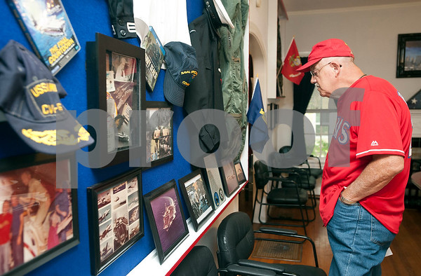 Veteran Chuck Thompson looks at Navy artifacts and photos during an open house Wednesday. The Green Zone is a resource center for veterans ran by veterans. Located at 512 Charnwood in Tyler, The Green Zone is open with peer councilors available from 9 a.m. to 5 p.m.   (Sarah A. Miller/Tyler Morning Telegraph)
