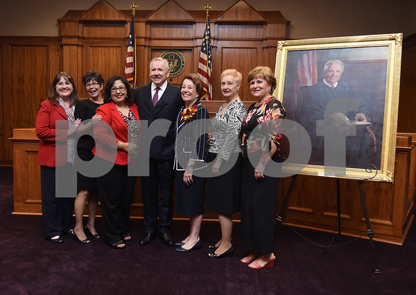 United States District Judge for the Eastern District of Texas Michael Schneider has his photo taken with his wife and co-workers during his retirement reception in Tyler Friday Sept. 23, 2016. Pictured from left: Shea Sloan, Jan Mason, Rosa Ferguson, Michael Schneider, Mary Schneider, Glenda Shelton and Linda Pritchard.  (Sarah A. Miller/Tyler Morning Telegraph)