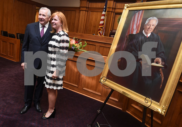 United States District Judge for the Eastern District of Texas Michael Schneider has his photo taken with Texarkana Magistrate Judge Caroline Craven during his retirement reception in Tyler Friday Sept. 23, 2016.  (Sarah A. Miller/Tyler Morning Telegraph)