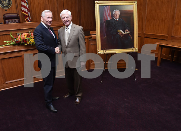 United States District Judge for the Eastern District of Texas Michael Schneider has his photo taken with Jim Knowles during his retirement reception in Tyler Friday Sept. 23, 2016.  (Sarah A. Miller/Tyler Morning Telegraph)