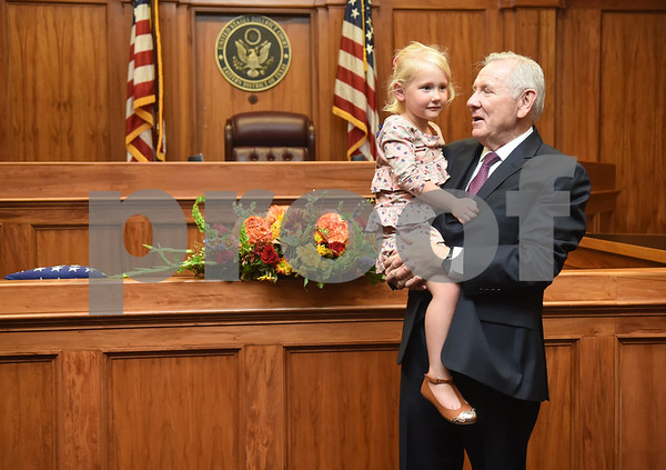 United States District Judge for the Eastern District of Texas Michael Schneider greets his granddaughter Ava Schneider, 4, during his retirement reception in Tyler Friday Sept. 23, 2016.  (Sarah A. Miller/Tyler Morning Telegraph)