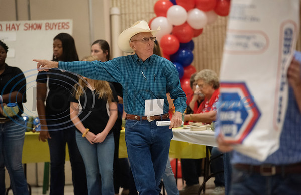 Don Malone points out a buyer to auctioneer Skyler Shively (not pictured) at the 35th annual Smith County Hay Show and Auction on Monday Sept. 23, 2019 at the 104th annual East Texas State Fair in Tyler. The top 25 hay entries were auctioned off to local businesses and residents to raise funds to support scholarships, the East Texas State Fair Junior Livestock Show and other programs.  (Sarah A. Miller/Tyler Morning Telegraph)