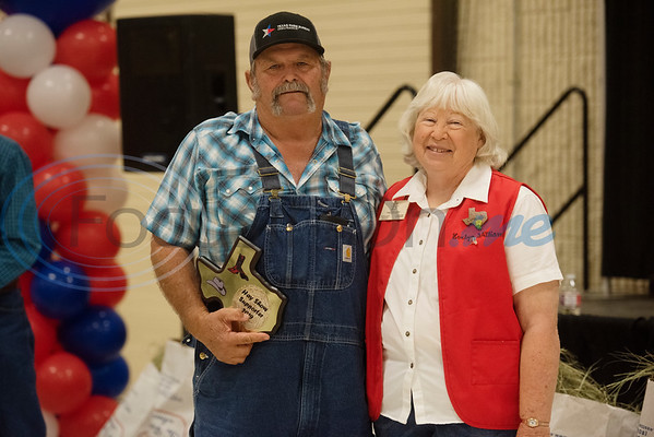 Jimmy Williams of Arp received the Hay Show Supporter Award, presented by his wife Evelyn.   (Sarah A. Miller/Tyler Morning Telegraph)