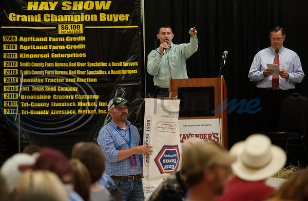 Auctioneer Skyler Shively acknowledges bids from buyers at the 35th annual Smith County Hay Show and Auction on Monday Sept. 23, 2019 at the 104th annual East Texas State Fair in Tyler. The top 25 hay entries were auctioned off to local businesses and residents to raise funds to support scholarships, the East Texas State Fair Junior Livestock Show and other programs.  (Sarah A. Miller/Tyler Morning Telegraph)